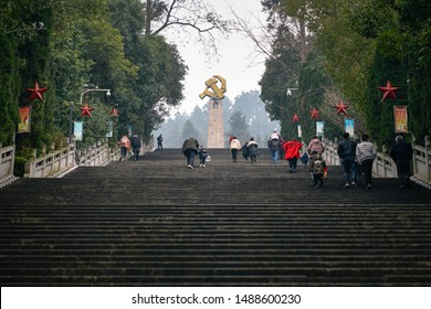 Zunyi, Guizhou, China - January 28 2019: Tourists climbing a large flight stairs to visit the Chinese Civil War memorial