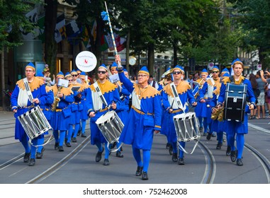 ZURICH - AUGUST 1: Zurich city orchestra in traditional costumes openning the Swiss National Day parade on August 1, 2016 in Zurich, Switzerland.