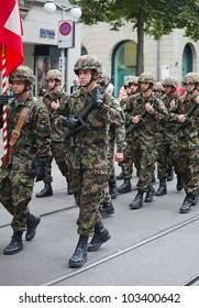 ZURICH - AUGUST 1: Swiss Infantry division taking part in Swiss National Day parade on August 1, 2009 in Zurich, Switzerland.