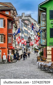 Zurich, Zurich Canton, Switzerland - April 13 2019: The medieval city of Zurich is beautiful despite wet and stormy spring weather on April 13, 2019