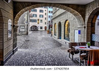 Zurich, Zurich Canton, Switzerland - April 13 2019: The medieval city of Zurich is beautiful despite wet and stormy spring weather on April 13, 2019