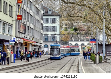 Zurich, Zurich Canton, Switzerland - April 13, 2019: Transportation diversity in Zurich includes trams and ferries seen on a spring day in April