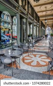 Zurich, Zurich Canton, Switzerland - April 13, 2019: Traditional street terrace cafe culture at the Cafe Bar Metropol, in Zurich, Switzerland