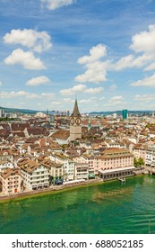 Zurich city center with St. Peter church, town hall and river Limmat - view from Grossmunster church on a sunny day with clouds in summer, Canton of Zurich, Switzerland