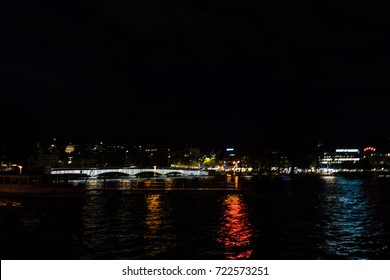 zurich city night view with lights with lake and water reflection switzerland travel tourism