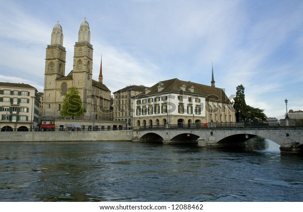 Zurich city panoramic view over Limmat river. Zurich Cathedral. Switzerland