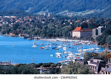 Zurich cityscape with old landmarks and Lake Zurich marina. Summertime Swiss panorama.