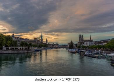 Zurich downtown skyline with Fraumunster and Grossmunster churches at lake zurich at night, Switzerland