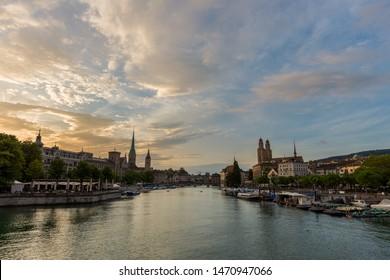 Zurich downtown skyline with Fraumunster and Grossmunster churches at lake zurich during beautiful sunset, Switzerland.