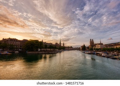 Zurich downtown skyline with Fraumunster and Grossmunster churches at zurich lake during beautiful sunset, Switzerland.