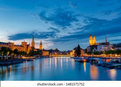 Zurich downtown skyline with Fraumunster and Grossmunster churches at zurich lake at night, Switzerland
