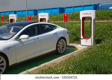 ZURICH - July 30:  Tesla Supercharger station on July 30, 2016 in Zurich, Switzerland. Tesla motors develops network of the charging stations across Europe and World.