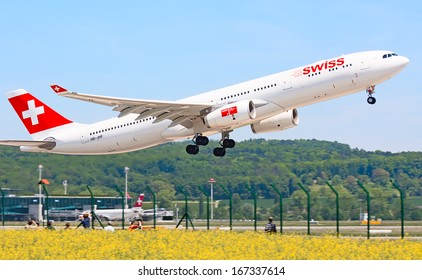 ZURICH - MAY 24:Swiss airlines Airbus A340 taking off on May 24, 2010 in Zurich, Switzerland. Zurich International Airport is one of the major Europian Hub and home port of Swiss airline.