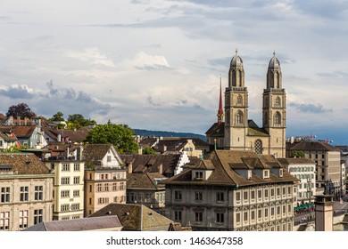 Zurich old downtown with famous Grossmunster Church and Limmat river from Lindenhof park, Zurich, Switzerland in summer