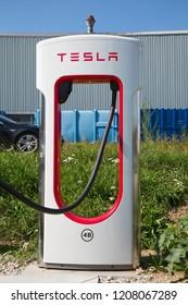 ZURICH - September 8:  Tesla Supercharger station on September 8, 2018 in Zurich, Switzerland. Tesla motors develops network of the charging stations across Europe and World.