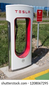 ZURICH - September 8:  Tesla Supercharger station on September 8, 2018 in Zurich, Switzerland. Tesla motors develops network of the charging stations across Europe and World.