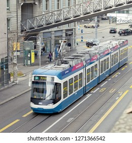 Zurich, Swiss Confederation November 10, 2018: City tram on the route under the funicular line.