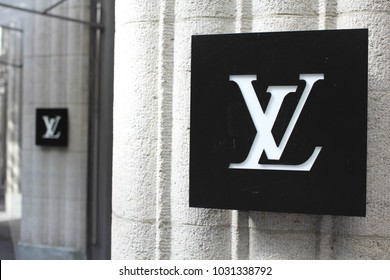 ZURICH, SWITERLAND - June 21, 2015: The monogram for Louis Vuitton Malletier, commonly known as Louis Vuitton, or shortened to LV, a fashion house and luxury retail company outside a boutique store.