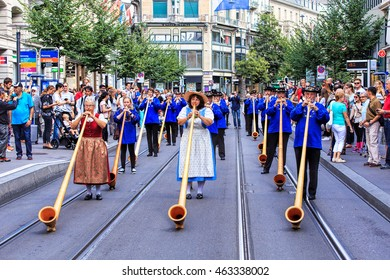 Zurich, Switzerland - 1 August, 2016: participants of the parade devoted to the Swiss National Day passing along Bahnhofstrasse street. The Swiss National Day is the national holiday of Switzerland.