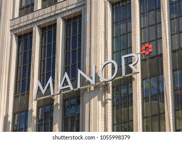 Zurich, Switzerland - 10 April, 2016: part of the facade of the Manor department store on Bahnhofstrasse street. Manor is a Swiss department store chain, headquartered in the city of Basel.