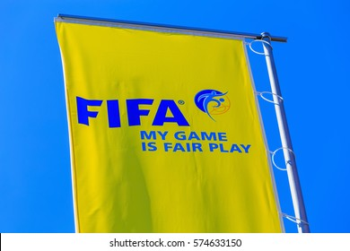 Zurich, Switzerland - 11 April, 2016: one of the flags at the entrance to the FIFA headquarters against blue sky. FIFA is the international governing body of association football and beach soccer.