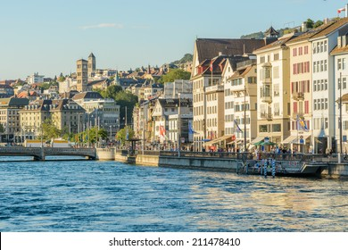 Zurich, Switzerland - 17 July, 2014: local people relax with the swans on Lake Zurich. Zurich is the largest city in Switzerland and the capital of the canton of Zurich.