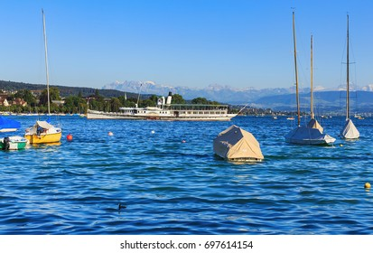 Zurich, Switzerland - 20 July, 2016: Lake Zurich in the evening. Lake Zurich is a lake in Switzerland, extending southeast of the city of Zurich.