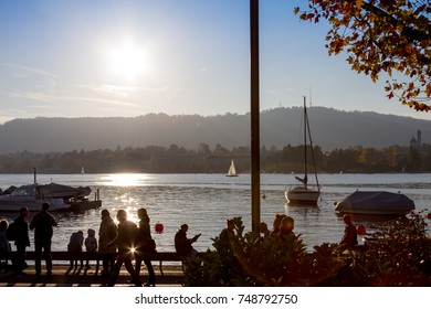 Zurich, Switzerland 2017-11-03 Sunset at lake promenade at Lake Zurich. The lake promenade is a popular place to enjoy sunshine
