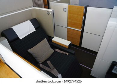 ZURICH, SWITZERLAND -21 AUG 2019- A luxury seat inside the First Class cabin of a Boeing 777-300 airplane from the Swiss international airline Swiss (LX), a member of Star Alliance.
