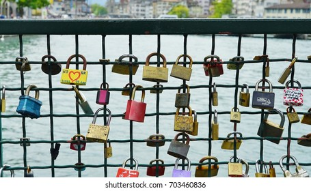 ZURICH, SWITZERLAND -23 JULY 2016- Locks of love attached to the fence on a bridge over the Limmat River in the center of Zurich, Switzerland.