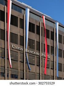 Zurich, Switzerland - 3 August, 2015: facade of the Union Bancaire Privee (UBP) building decorated with flags. UBP is a full-scale wealth-management bank, headquartered in Geneva, Switzerland.