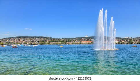 Zurich, Switzerland - 3 July, 2014: fountain on Lake Zurich. Lake Zurich (German: Zuerichsee) is a lake in Switzerland, extending southeast of the city of Zurich.