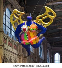 Zurich, Switzerland - 9 October, 2016: the famous Nana figure in the hall of the Zurich main railway station. The figure was created by a French sculptor, painter and filmmaker Niki de Saint Phalle.