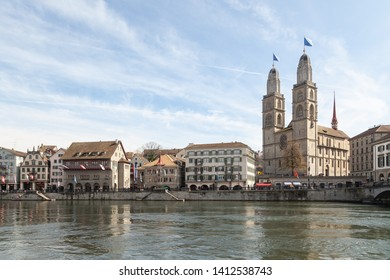 ZURICH, SWITZERLAND - APRIL 06, 2019: Church of Grossmunster and reflection in Limmat River, Zurich, Switzerland