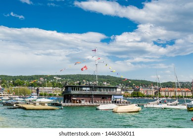 Zurich, Switzerland- April 29, 2018: A beautiful restaurant and yachts at the pier on Lake Zurich, view from the city. Lake Zurich is a lake in Switzerland, at the southeast of the city of Zurich.