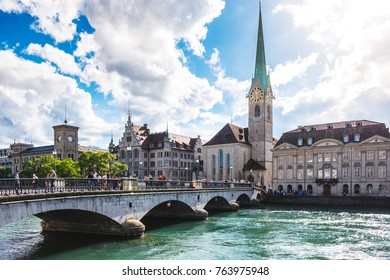 ZURICH - SWITZERLAND : AUG 8'17 : Beautiful view of the historic city center of Zurich with famous Fraumunster Church Limmat on a sunny day with blue sky, Canton of Zurich, Switzerland
