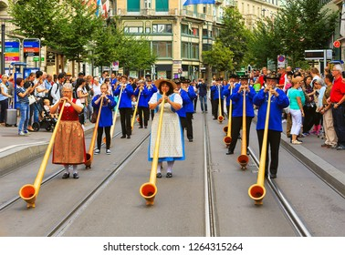 Zurich, Switzerland - August 1, 2016: participants of the parade devoted to the Swiss National Day passing along Bahnhofstrasse street. The Swiss National Day is the national holiday of Switzerland.