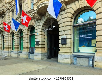 Zurich, Switzerland - August 1, 2016: facade of the Credit Suisse building on Paradeplatz square decorated with flags of Switzerland and Zurich for the Swiss National Day celebrated on 1 August.