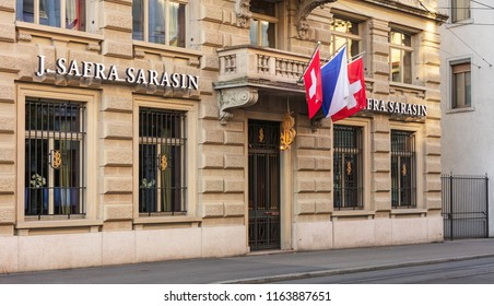 Zurich, Switzerland - August 1, 2018: office of Bank J. Safra Sarasin on Bleicherweg street, decorated with flags. Bank J. Safra Sarasin Ltd is a leading sustainable private bank.