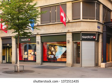 Zurich, Switzerland - August 1, 2018: Swatch store on Bahnhofstrasse street. Swatch is a brand of the Swatch Group - an international group active in the design, manufacture and sale of watches.