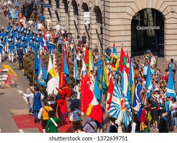 Zurich, Switzerland - August 1, 2018: participants of the parade devoted to the Swiss National Day passing along Uraniastrasse street in the city of Zurich.