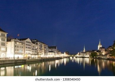 ZURICH, SWITZERLAND - AUGUST 2017: Night view of Zurich, the city centre and the river Limmat.