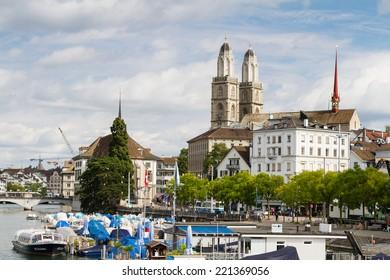ZURICH, SWITZERLAND - AUGUST 25: View of Limmat river and famous Zurich churches in Zurich, Switzerland on August 25, 2014. Zurich is the biggest city and main economic center in Switzerland.