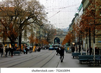 Zurich, Switzerland, Central Europe, Bahnhofstrasse looking towards the Zurich Central Station, with tram tracks and pedestrians.