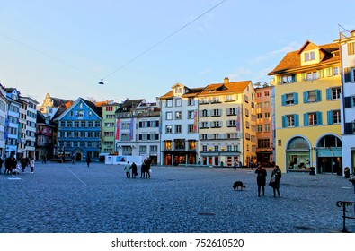 Zurich, Switzerland, Central Europe, Munsterhof square next to Fraumunster with cobbled pavement and colorful buildings.