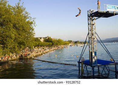 ZURICH, SWITZERLAND - CIRCA AUGUST 2010 - A man is jumping into the Lake of Zurich (Zurichsee) circa August 2010 in Zurich. Zurich is a famous tourist destination in summertime too.