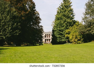 ZURICH, SWITZERLAND - CIRCA OCTOBER 2017: The old building of Rietberg Museum facing the greenery.