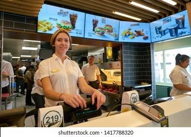 ZURICH, SWITZERLAND - CIRCA OCTOBER, 2018: indoor portrait of staff in McDonald's restaurnat in Zurich.