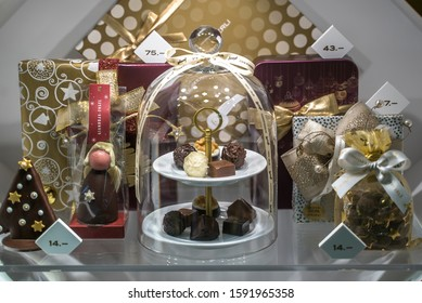 ZURICH, SWITZERLAND - DECEMBER 12, 2019: Chocolate products in display window of the Sprungli shop.