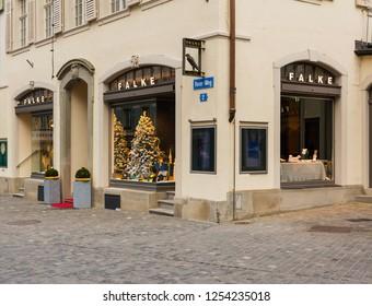 Zurich, Switzerland - December 6, 2015: Falke store on Renn-Weg street in the historic part of the city of Zurich in the advent season. Falke is a brand of the Falke Gruppe company, based in Germany.